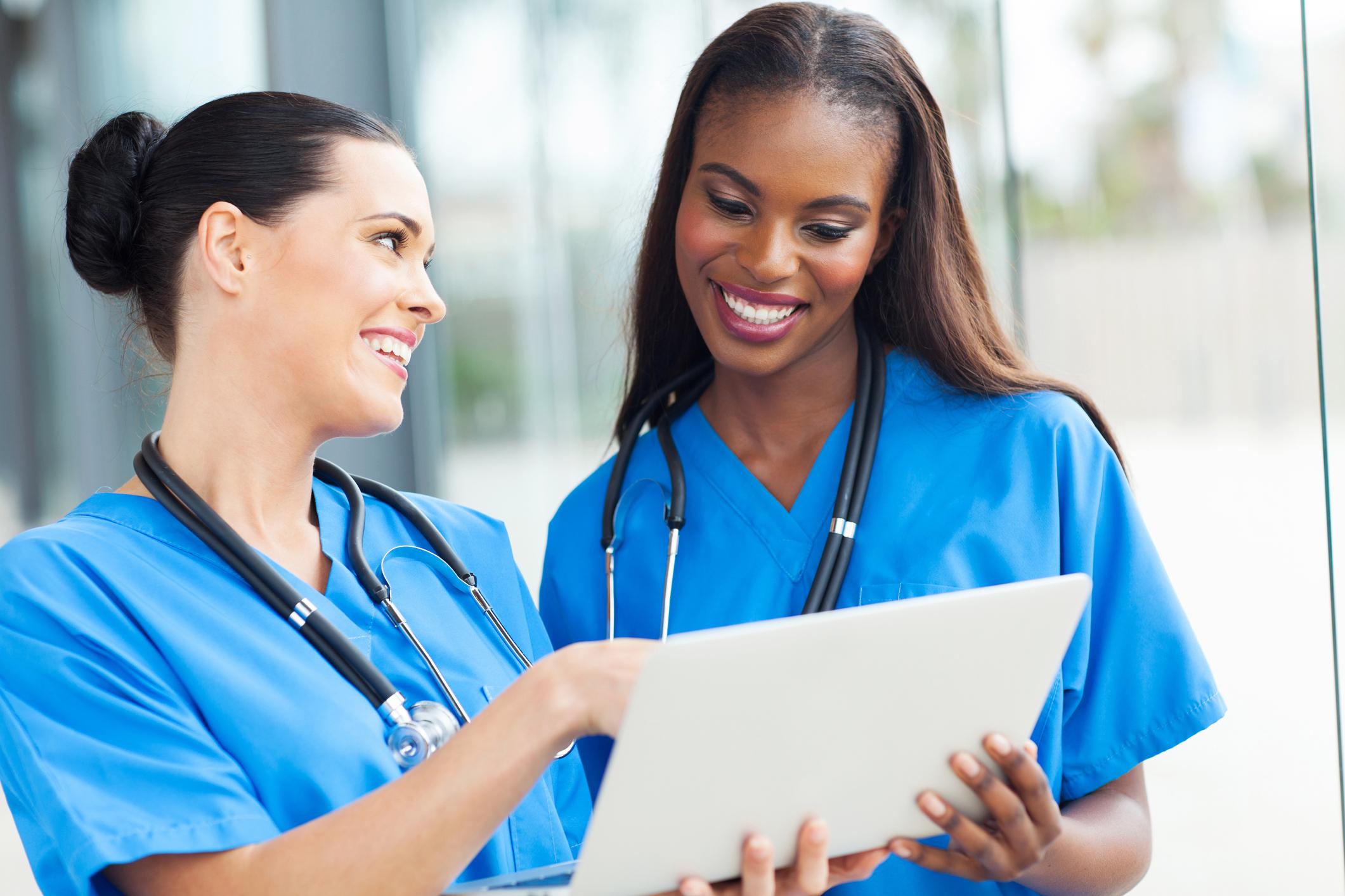 two pretty nurses using laptop computer